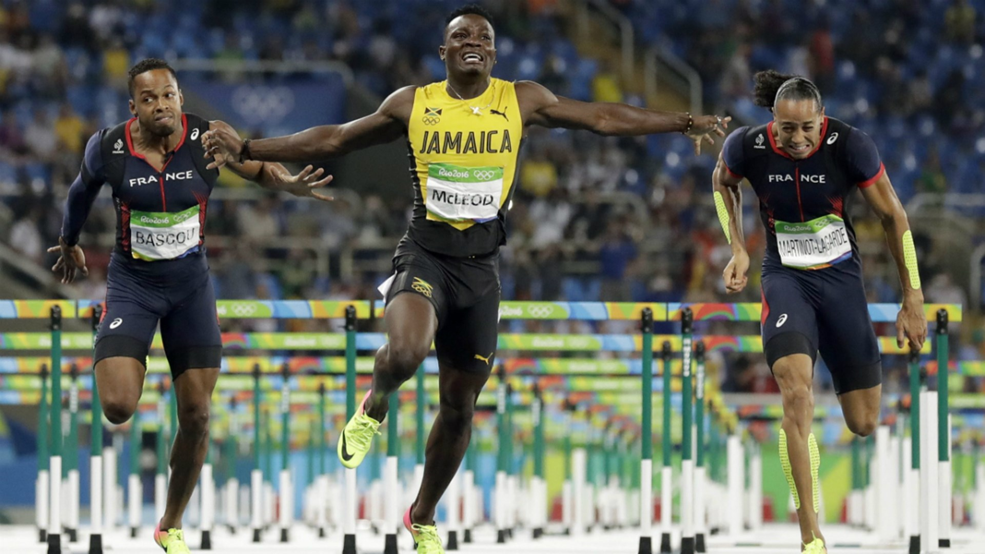Jamaica's Omar McLeod (centre) reacts after winning gold in the Men's 110m hurdles final flanked by the French pair of Dimitri Bascou (left) and Pascal Martinot-Lagarde inside the Olympic Stadum last night. (Bryan Cummings)